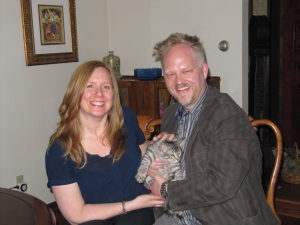 Katmandu loves being held by Maurice and having his back scratched by Carmen.