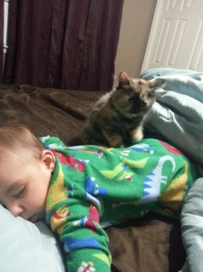 Chloe watching over Jayden as he sleeps.