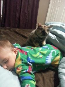 Chloe watching over Jayden as he sleeps.