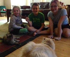 Maggie, Patrick, Annie and Roscoe play with Abby.
