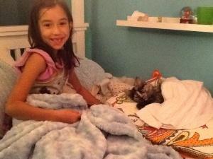 Kiki loves taking care of Izzy.